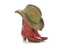 Rode geïsoleerdea veedrijfsterlaarzen en hoed royalty-vrije stock fotografie
