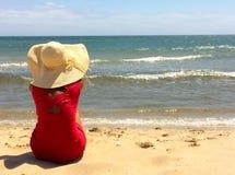 Rode geklede vrouw Stock Afbeeldingen