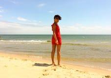 Rode geklede vrouw Stock Afbeelding