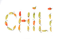Rode gele en groene paprika'sspelline uit C h i l i. Stock Foto