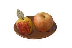 Rode gele en kunstmatige appelen Stock Foto's