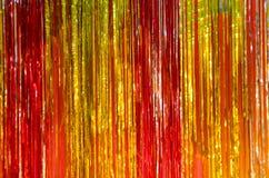 Rode gele en oranje achtergrond van het flikkerings de glanzende klatergoud stock foto
