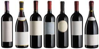 Rode geplaatste wijnflessen Stock Foto