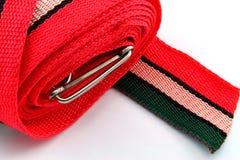 Rode gestreepte riem stock afbeelding