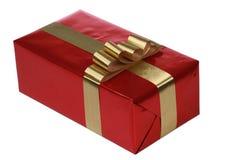 Rode gift met gouden linten Stock Foto