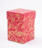 Rode giftdoos met gouden patroon Stock Afbeelding