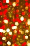 Rode gouden gloeiende achtergrond. Kerstkaart. Royalty-vrije Stock Fotografie