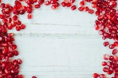 Rode granaatappelgrens Kader van granaatappelzaden stock fotografie