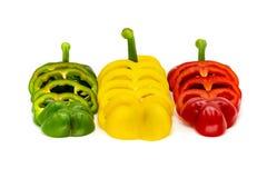 Rode, Groene en Gele Spaanse pepersplakken die op een witte achtergrond worden gescheiden royalty-vrije stock afbeelding