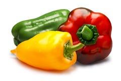 Rode, groene en gele zoete groene paprika's, wegen Royalty-vrije Stock Afbeeldingen