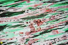 Rode groene fosforescerende zwarte wasachtige druppelsverf De abstracte achtergrond van de waterverfverf Stock Afbeelding