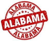 Rode grunge van Alabama om zegel Stock Foto's
