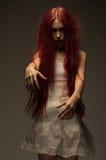 Rode haired zombievrouw stock foto's