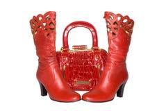 Rode handtas en laarzen stock foto's