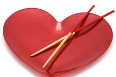 Rode hart en eetstokjes Stock Afbeeldingen