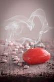 Rode hart gevormde kaars Stock Foto