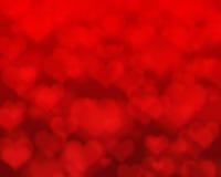 Rode harten bokeh als achtergrond Stock Foto