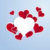 Rode harten met het witte inkten op een blauwe achtergrond Royalty-vrije Stock Fotografie