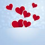 Rode harten met het witte inkten op een blauwe achtergrond Royalty-vrije Stock Foto's