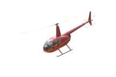 Rode helikopter die over wit wordt geïsoleerd Royalty-vrije Stock Afbeeldingen