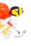 Rode helm en werkende hulpmiddelen Stock Fotografie