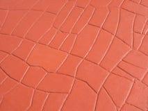 Rode het patroonachtergrond van de zegel concrete textuur Stock Fotografie