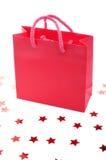 Rode het winkelen zak en sterren stock fotografie