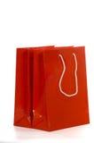 Rode het winkelen zakken op wit Stock Foto