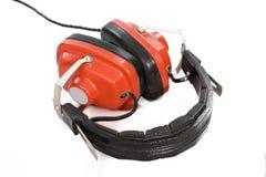 Rode hoofdtelefoons. Stock Foto's