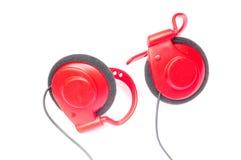 Rode hoofdtelefoons Royalty-vrije Stock Afbeelding