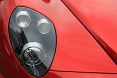 Rode Italiaanse moderne sportwagenkoplamp Royalty-vrije Stock Afbeeldingen