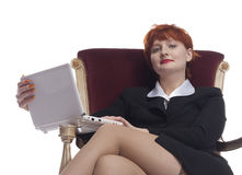 Rode jonge vrouw in sexy pak Stock Afbeelding