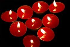 Rode kaarsen Stock Afbeeldingen