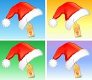 Rode Kerstmishoeden met prijskenteken Stock Afbeeldingen