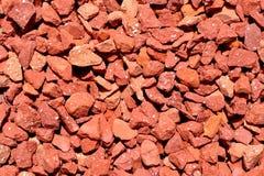 De rode textuur van kiezelstenen stock foto afbeelding bestaande