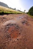 Rode kleiweg met gaten Royalty-vrije Stock Afbeelding