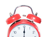 Rode klok bij middernacht/middag stock foto's
