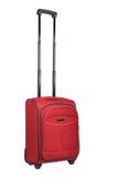 Rode koffer op wielen (die op wit worden geïsoleerde) Royalty-vrije Stock Afbeeldingen