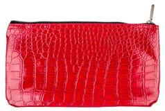 Rode kosmetische die zak op wit wordt geïsoleerd Stock Fotografie