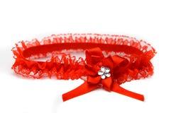 Rode kouseband die op witte achtergrond wordt geïsoleerdo Royalty-vrije Stock Foto