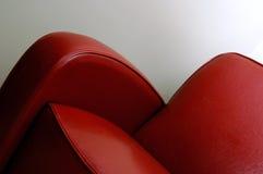 Rode leerstoel Stock Fotografie