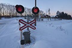 Rode lichten bij railrod kruising Stock Fotografie