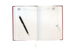 Rode organisator en pen Stock Afbeelding
