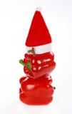 Rode paprika met de rode hoed van de Kerstman Royalty-vrije Stock Afbeeldingen