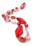 Rode parels met roze kristallen stock afbeelding