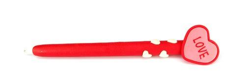 Rode pen met hart op de bovenkant Stock Afbeeldingen
