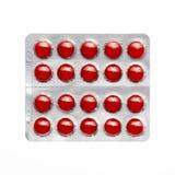 Rode pillen in een blaarpak Stock Afbeeldingen