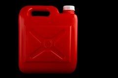 Rode Plastic Vloeistoffencontainer op een Zwarte Achtergrond Stock Afbeelding
