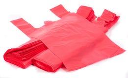 Rode plastic zakken Stock Foto