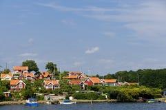 Rode plattelandshuisjes in Brandaholm, Zweden Royalty-vrije Stock Foto's
